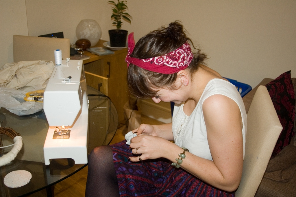 Rosie gets to work on the sewing maching