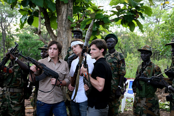Invisible Children activists posing with the Ugandan Army